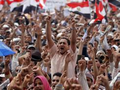 Thousands of Islamists chant slogans as they rally in Tahrir Square to denounce presidential candidates in Cairo on Friday.