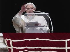 Pope Benedict XVI greets the crowd Sunday from his studio's window overlooking St. Peter's Square at the Vatican.