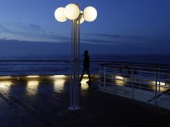 A passenger of the MS Balmoral Titanic memorial cruise ship gazes out to the Atlantic Ocean early Sunday after a service marking the anniversary of the Titanic disaster.