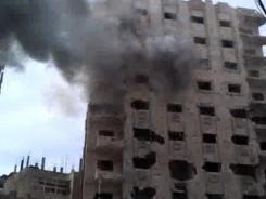 This image made from amateur video and released by Bambuser on Saturday purports to show smoke from shelling in Homs, Syria.