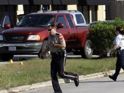 Members of the Montgomery County Sheriff's Department work the crime scene where a mother was killed and her baby was kidnapped April 17, in Spring, Texas.
