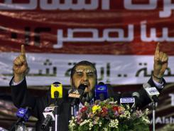 Egypt's Muslim Brotherhood presidential candidate Khairat el-Shater talks to reporters during a press conference Tuesday in Cairo.