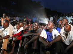 Ugandans watch Kony 2012, a 30-minute YouTube video uploaded by non-profit group Invisible Children, in the Lira district on March 13.