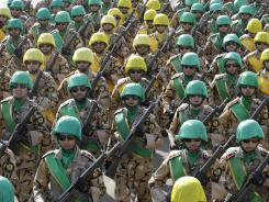 Iranian troops march during Tuesday's military parade commemorating National Army Day outside Tehran.