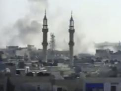 Video shows smoke rising Tuesday from shelling by Syrian government forces in Homs.