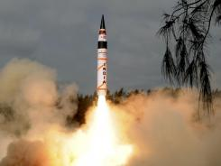 In this photo released by the Indian Ministry of Defense, India's Agni-V missile lifts off from the launch pad off India's east coast on Thursday.