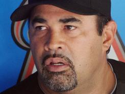 Miami Marlins manager Ozzie Guillen talks with reporters in the dugout at Marlins Park after serving a five-game suspension stemming from pro-Fidel Castor comments.