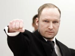 Anders Behring Breivik, who is on trial for deadly attacks, gestures Wednesday at a courtroom in Oslo.