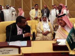 Saudi Arabia's Prince Saudi al-Faisa, right, speaks to Sudan's Kamal el-Din Hassan Ali during Tuesday's meeting of the Committee of Ministers of the Arab League to discuss Syria.