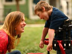 Babysitter Samantha McLeod interacts with 5-year-old Brian Quayle. Families who have used services like SpecializedSitters.com say they have been pleased with the attention to detail.