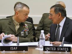 "Marine Gen. John Allen, left, with U.S. Defense Secretary Leon Panetta in February, said the images are ""entirely inconsistent"" with the ISAF values."
