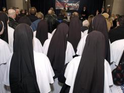 Catholic nuns listens to former Presidential Candidate Rick Santorum speak in February in Michigan.
