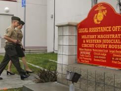 Marine Corps Staff Sgt. Frank Wuterich, left, arrives with his attorney for a court session Jan. 24 at Camp Pendleton.