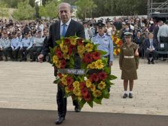 Israeli Prime Minister Netanyahu lays a wreath during the annual ceremony in memory of six million Jews who perished in the Nazi holocaust, on Holocaust Remembrance Day at Yad Vashem memorial in Jerusalem.