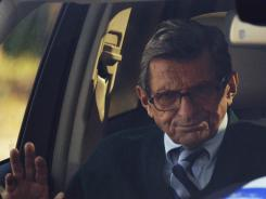 In this Nov. 9, 2011, file photo, Penn State football coach Joe Paterno arrives home in State College, Pa.