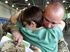 Army 1st Sgt. Jason Friedly hugs his son Tanner, 11, during the 82nd Airborne Combat Aviation Brigade deployment to Afghanistan from Fort Bragg, N.C., on Sept. 12, 2011.