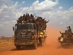 South Sudan People's Liberation Army vehicles drive on the road from Bentiu to Heglig, on April 17.