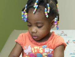 Dr. Najeeba Bootwala conducts a health check on Yari Broussard, 2, at Oakhurst Medical Center in Stone Mountain.