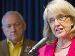 Arizona State Senator Russell Pearce and Gov. Jan Brewer hold a press conference discussing the state's SB 1070 appeal May 9, 2011, in Phoenix.