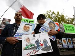 Demonstrators gather on Saturday outside the Formula One headquarters in London. Protesters urge the cancellation of the Formula One race in Bahrain.