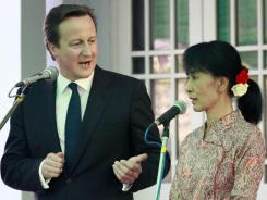 British Prime Minister David Cameron and Myanmar pro-democracy icon Aung San Suu Kyi speak to journalists during a joint press conference April 13.