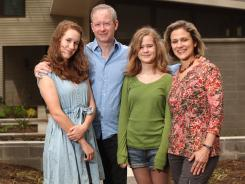 Wendy Koch and her husband, Alex, and children Grace, 11, and Mary, 15, left, at their home in Falls Church, Va.