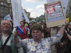 A Czech woman holds a sign saying 'Stop the Government' during a protest rally on Saturday in Prague's Wenceslas Square.