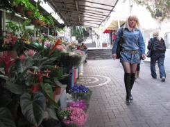 A woman walks past a flower shop in Haifa, Israel, in February 2011. After months of negotiations, Google has launched its Street View service in Haifa, Jerusalem, Tel Aviv.
