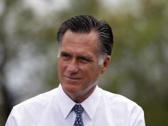 Mitt Romney listens to Pittsburgh-area residents in Bethel Park, Pa., during a campaign stop April 17. Outside groups supporting him have surpassed his campaign's fundraising.