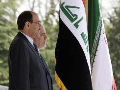 Iraqi Prime Minister Nouri al-Maliki, left, and Iranian Vice-President Mohammad Reza Rahimi, listen to their countries' national anthems during an official welcoming ceremony for al-Maliki in Tehran, Iran, on Saturday.