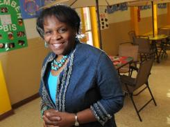 Priscilla Pullen, principal of Midway Elementary Professional Development School in Shreveport, La., stands in the school's Mustang Cafe area, where students are rewarded for good behavior after earning Mustang bucks.