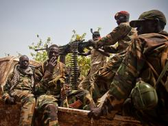 Soldiers of South-Sudan's Sudan People's Liberation Army leave the Rubkona Military Hospital in Rubkona, South Sudan, on Friday.