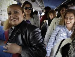 Women arrive in a bus before their meeting with men Saturday in Candeleda, Spain.