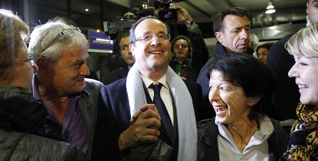 French socialist candidate Francois Hollande, center, arrives at Brive airport in Brive after the first round of the presidential election Sunday.