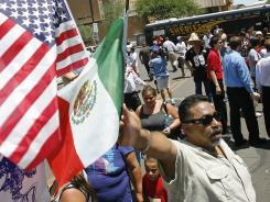 Edward Pina protests Arizona's SB1070 immigration-enforcement law in Phoenix.