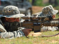 Pfc. Robert Hamersly, left, and Pfc. Michael Trischler shoot at targets at the Army's Sniper School.