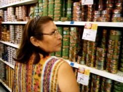 A woman looks at goods in a local Wal-Mart in Cancun, Mexico.