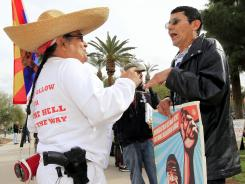 At the Arizona Capitol: Arthur Olivas, left, a proponent of the state's new immigration law, argues with opponent Andy Hernandez in January in Phoenix.