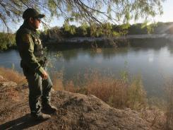 U.S. Border Parol agent Hipolito Coy looks across the Rio Grande River near Hidalgo, Texas, toward Mexico in November.