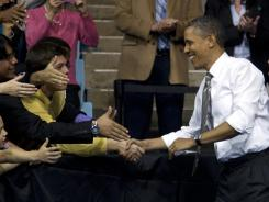 President Obama greets the crowd as he arrives to speak at the University of North Carolina at Chapel Hill on Tuesday.