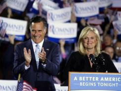 Mitt and Ann Romney celebrate Tuesday night at an election rally in Manchester, N.H.