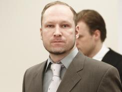 Anders Behring Breivik arrives in an Oslo courtroom Tuesday. He defended his sanity in a massacre.