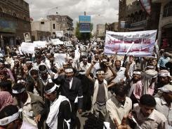 Peaceful Revolution Salvation Front members chant slogans during Monday's demonstration for independence of the judicial system in Sanaa, Yemen.