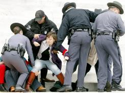Police remove protesters from the steps of the state Capitol in Richmond, Va., on March 3.