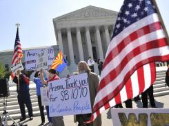 Supporters of Arizona's immigration law rally outside the United States Supreme Court during arguments Wednesday.
