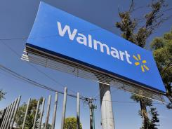 Wal-Mart signage is seen in the parking lot of a store in Mexico City on Monday.