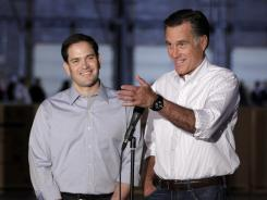 Mitt Romney, accompanied by Sen. Marco Rubio, R-Fla., talks to reporters in Aston, Pa., on April 23.