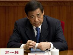 Bo Xilai attends a plenary session of the National People's Congress at the Great Hall of the People in Beijing on March 11.