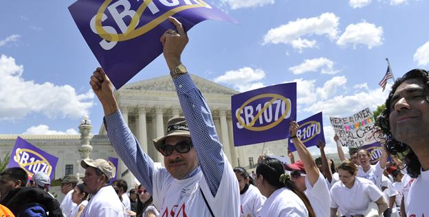 Opponents of Arizona's immigration law rally outside of the United States Supreme Court on Wednesday.