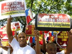 Protesters hold a rally April 20 outside the Chinese Consulate in Makati, Philippines, to protest the current standoff between Philippine and Chinese vessels in the South China Sea.